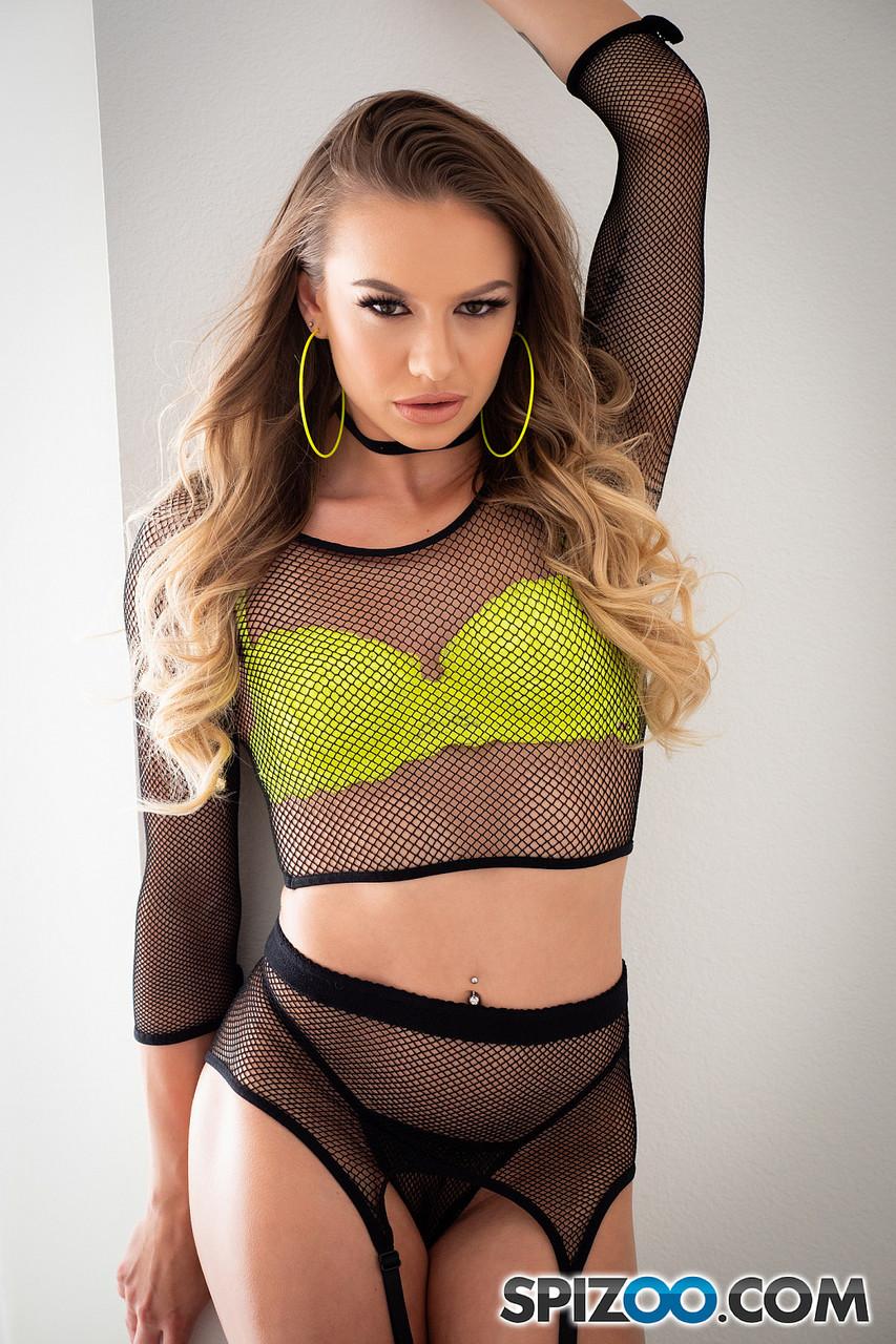 Petite blonde Naomi Swann flashing her hot body in sexy fishnets high heels