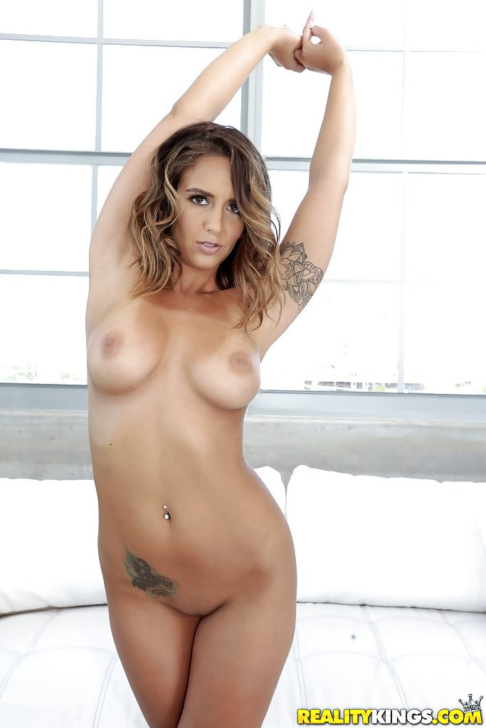 Top pornstar Layla London exposing big boobs and sexy round butt