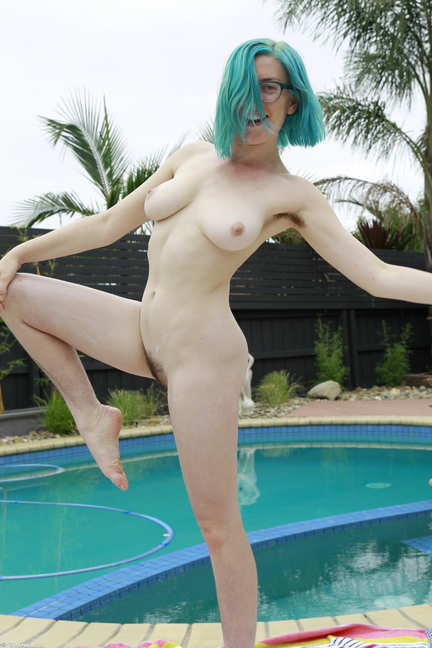 Blue haired amateur Arial uncovers her natural tits  natural muff by the pool