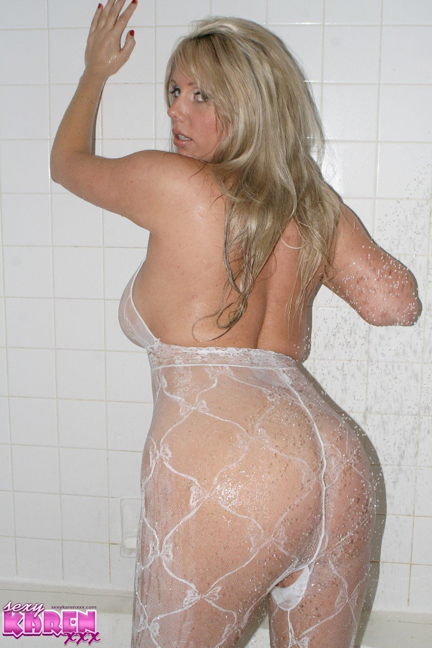 Thick blonde Karen Fisher bares big boobs while showering in a bodystocking
