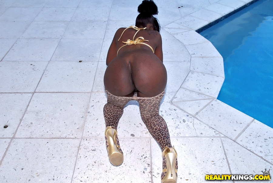 Hot ebony babe with big tits undressing to show her big ass outdoor