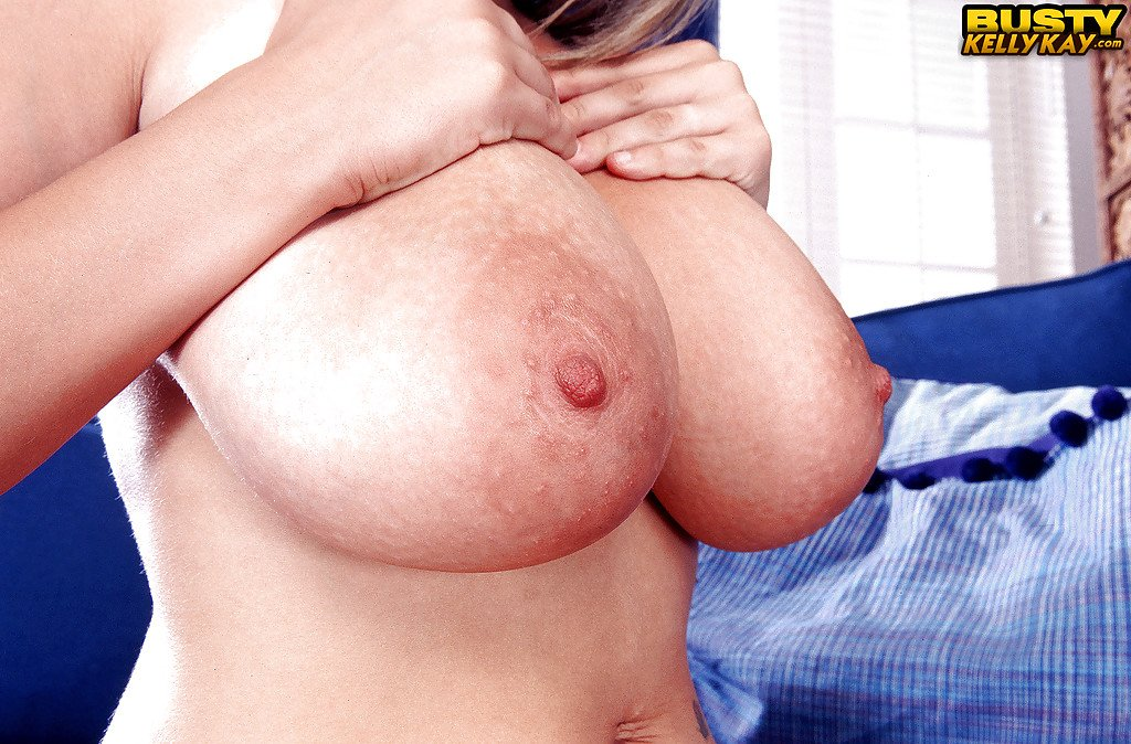 Chubby Euro babe Kelly Kay revealing massive pornstar boobs and hairy pussy