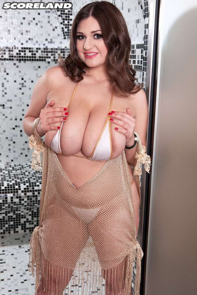 Solo model Demmy Blaze rocks her huge boobs in the shower