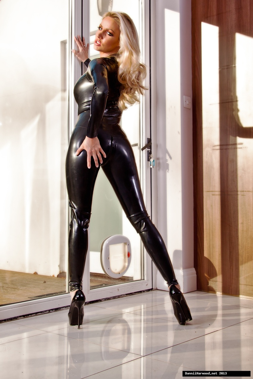 ... Hot MILF pornstar in latex catsuit and heels flaunting her sexy ass ...