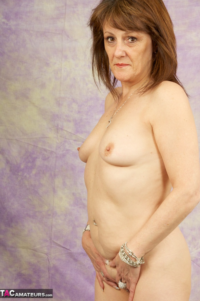 ... Horny mature Pandora with small saggy tits bends over naked in high  heels ...