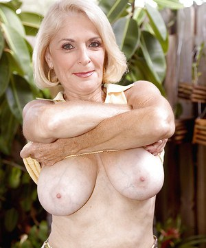 Mature temptress Georgette Parks exposing puffy boobs and toying old snatch