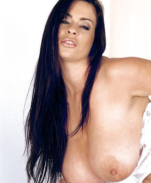 Linsey Dawn McKenzie brings out massive hooters from white lingerie