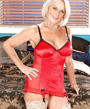 Busty mature blonde in red lingerie Georgette Parks getting drilled by two dicks