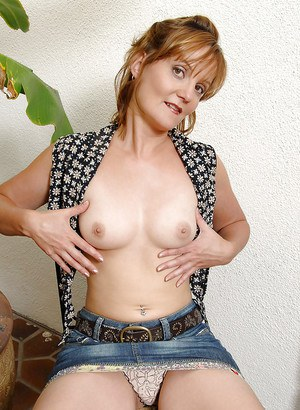 Lovesome mature in jeans miniskirt fingering her tight pink pussy