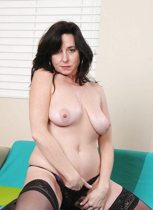 Big titted mature mom Karen Kougar jamming a big toy in her tight pussy
