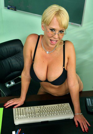 Big titted teacher in glasses Carly Parker strips from black lingerie