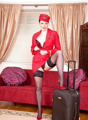 Busty MILF in flight attendant uniform and stockings Holly Kiss strips