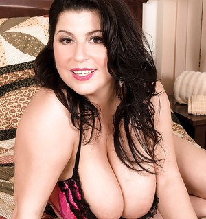 BBW brunette Natalie Fiore posing in underwear and showing fat tits