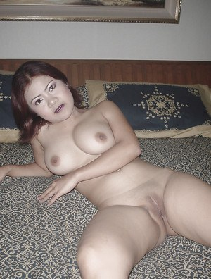 Chubby asian babe with petite melons stripping and spreading her legs
