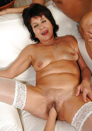 Lusty mature brunette in stockings gets her cunt fisted and nailed hardcore