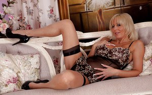 Stunning mature blonde in lingerie stripping and playing with her sex toy