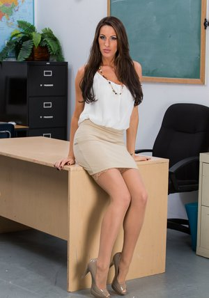Sexy teacher in stockings Kortney Kane stripping in the classroom