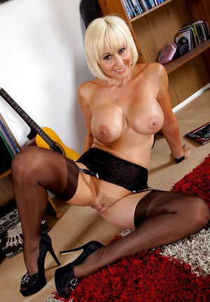 Naughty mature blonde in stockings undressing and teasing her slit