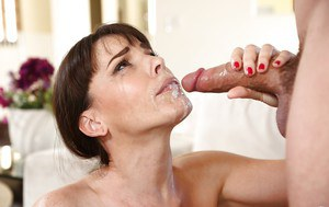 Dana DeArmond is giving a deep blowjob and getting cum on boobies