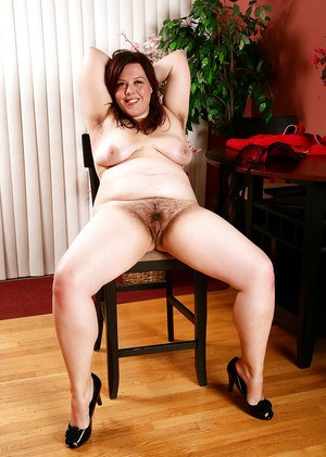 Mature BBW in high heels shows off big butt and hairy vagina