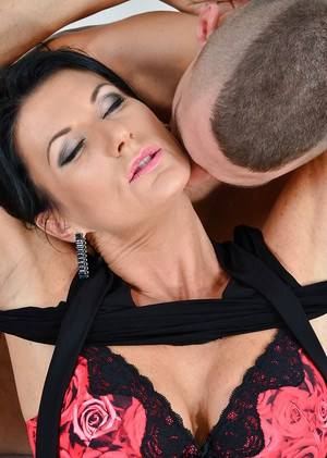 Stocking wearing MILF Celine Noiret sucking big cock before riding on top