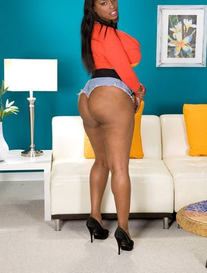 Ebony fatty Melissa Reed bends to show off her ass and fingers her twat
