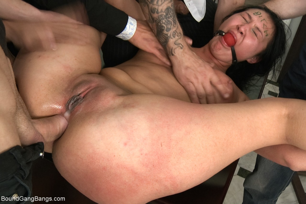 Helpless secretary is held down and butt fucked during a gangbang at work
