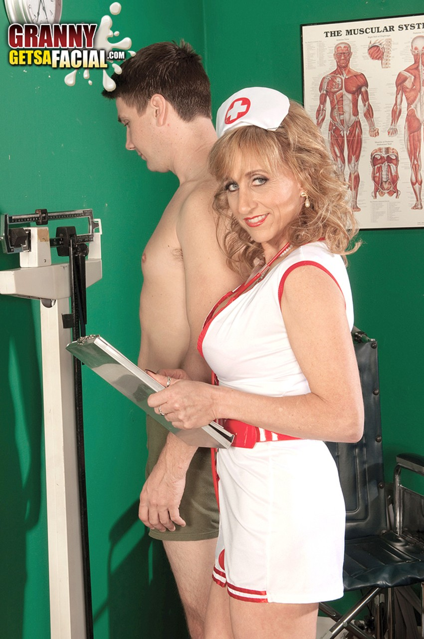 Mature nurse Shana DuPlae takes a semen sample from a younger patient ...