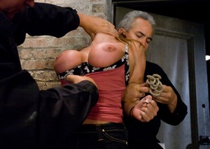 American female Christina Carter is tortured by her male handlers