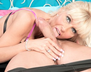 American mature blonde Stormy Lynne helps lover to forget about working day