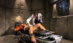 Female doctor relieves a restrained patient of her sexual tensions
