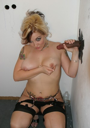 Slut with tattooed body Candy Monroe got black cock out of the gloryhole