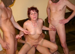 Mature slut Elene gets gangbanged by a couple of horny masked dudes