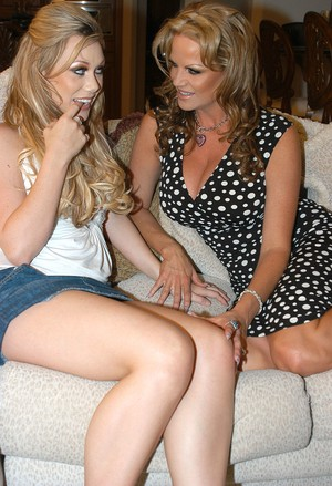Samantha Sin and Kelly Madison enjoy a sweet treat before going lesbian
