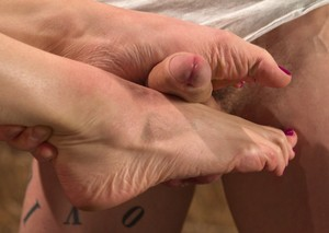 Short haired Lily LaBeau gets jizz on her feet after delivering a footjob