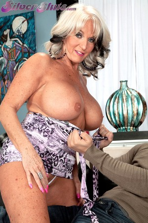 Big boobed mature lady Sally DAngelo tastes her toy boys jizz after fucking