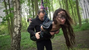 Belgian female Julie Skyhigh is taken into woods for BDSM training session