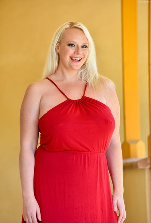 Blonde BBW Cameron frees her huge boobs with pierced from a red dress
