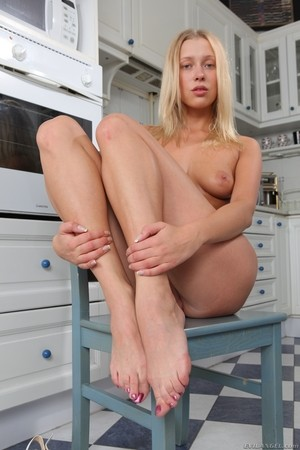 Russian babe in stockings Teena Lipoldina delivers a hot blowjob and footjob
