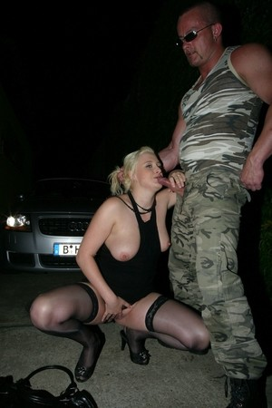 Blonde amateur takes a piss on the road while squatting to suck cock
