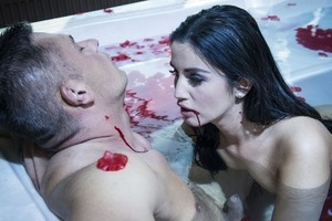 Sexy vampire takes her dress off and bites a muscle fella in the hot tub