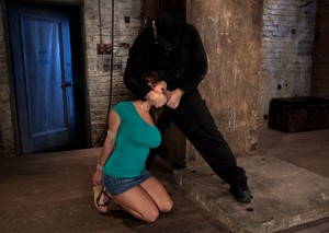 Big boobed MILF Trina Michaels gets tied up and dominated in the dungeon