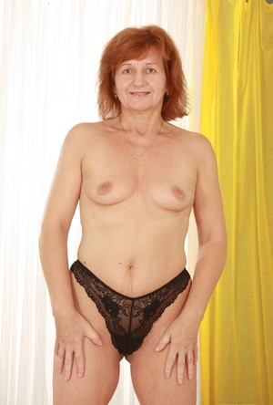 Short-haired grannies demonstrate their breasts letting take some pics of it