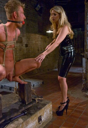 Hot blonde Jordan Kingsley flogs and paddles a male sub in black latex dress