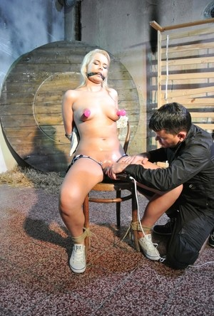 Hot blonde Nikki Dream in tight dress chair tied for painful nipple suction