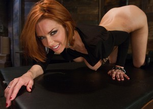 Alluring redhead Veronica Avluv performs hot striptease in the BDSM dungeon