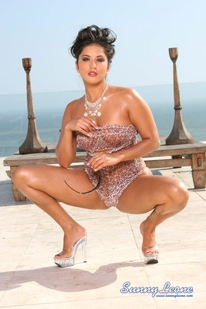 Super sexy glamorous Sunny Leone crouches topless and oiled in the sunshine