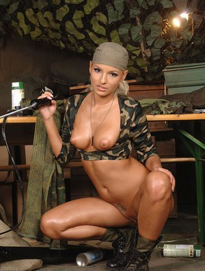 Busty babe Eve Smile having asshole fucked by sex machine in military garb