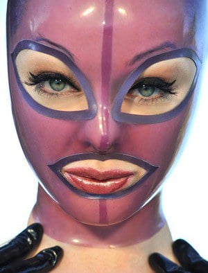 Latex Lucy frees her big tits and twat from lingerie in a rubber mask