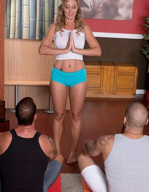 Middle aged yoga practitioner Jenna Covelli shows 2 young guys a good time